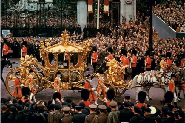 Elizabeth is borne from Westminster Abbey in a gold coach first used for the state opening of parliament by George III in 1762. (Getty Images)