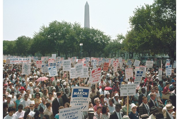 Civil rights marchers pass the Washington Monument in August 1963. (Corbis)