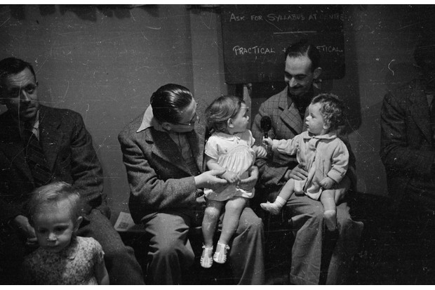 Fathers and children attending a class organised by the Mothercraft Training Society at their centre in Kingston-on-Thames, 29 July 1939. (Photo by Gerti Deutsch/Picture Post/Getty Images)