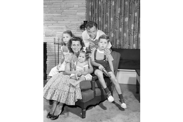 FRANK SINATRA -- Pictured: Frank Sinatra & family: (top clockwise) Singer/actor Frank Sinatra, son Frank Sinatra Jr., daughter Tina Sinatra, wife Nancy (Barbato) Sinatra, daughter Nancy Sinatra in July, 1949 -- Photo by: Herb Ball/NBC/NBCU Photo Bank