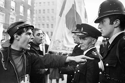 A demonstrator vents his spleen at police officers during an anti-Vietnam War rally in London's Grosvenor Square