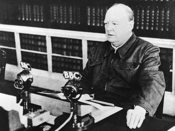 """Churchill delivering his """"I have nothing to offer but blood, toil, tears and sweat"""" speech over BBC radio in 1940. (Keystone-France/Gamma-Keystone via Getty Images)"""