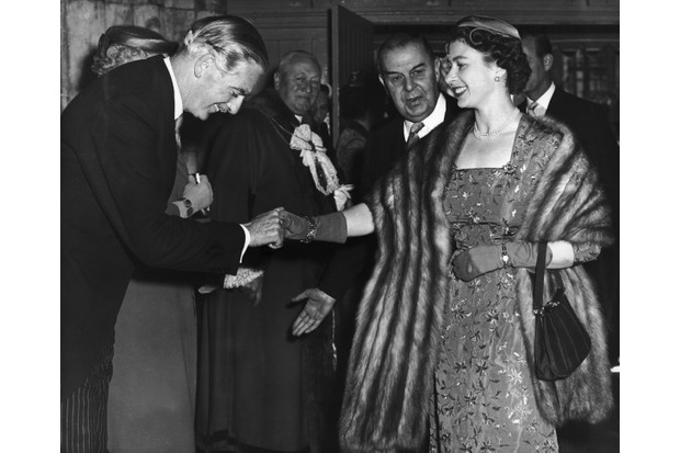 The Queen shakes Anthony Eden's hand at a gala in 1956. Season two of 'The Crown' will cover Eden's premiership and how the prime minister concealed the Suez conspiracy from the monarch. (Photo by Keystone-France/Gamma-Keystone via Getty Images)