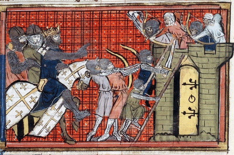 c1754: Siege of a town led by Godefroy de Bouillon (c1060-1100) 1st Crusade (1095-1099), showing Saracens firing arrows at Crusaders as they attempt to scale the walls. From manuscript of Roman de Godefroy de Bouillon. (Photo by Universal History Archive/Getty Images)