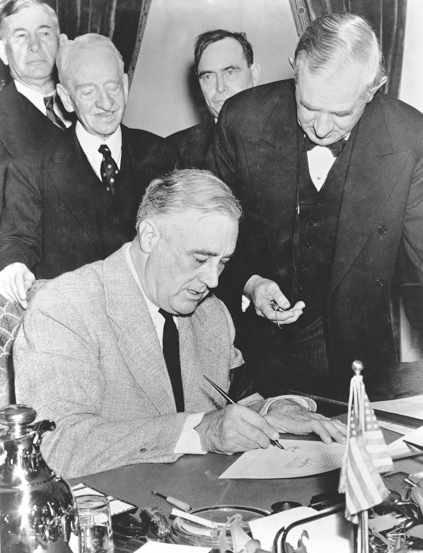 The day after the attack on Pearl Harbour United States President Franklin Delano Roosevelt signs the declaration of war against Japan in Washington DC on after addressing a joint session of Congress and, via radio, the nation, 8th December 1941.  The Senate responded with a unanimous vote in suppport of the war; only one Representative dissented in the House.  This image is from the archives of the United States Library of Congress. Please credit. (Photo by Popperfoto/Getty Images)