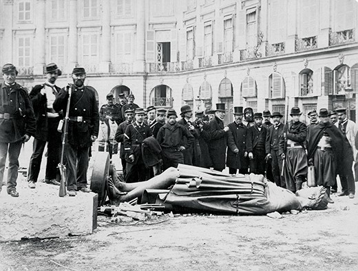 The overthrow of the statue of Napoleon I which was on top of the Colomne Vendome, during the civil war between the Third Republic and the Paris Commune, following the Franco-Prussian war. The painter Gustave Courbet is ninth from the right (with large beard). From the Marguerite Millan Collection.   (Photo by Hulton Archive/Getty Images)