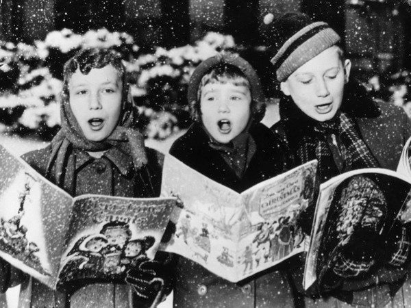 Three young carol singers. (Photo by Keystone/Getty Images)