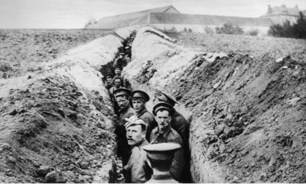 "British soldiers lined up in a narrow trench. ""Launching a successful attack against an enemy trench was one of the most difficult problems facing commanders on both sides,"" says Seán Lang. (Photo by Getty Images)"