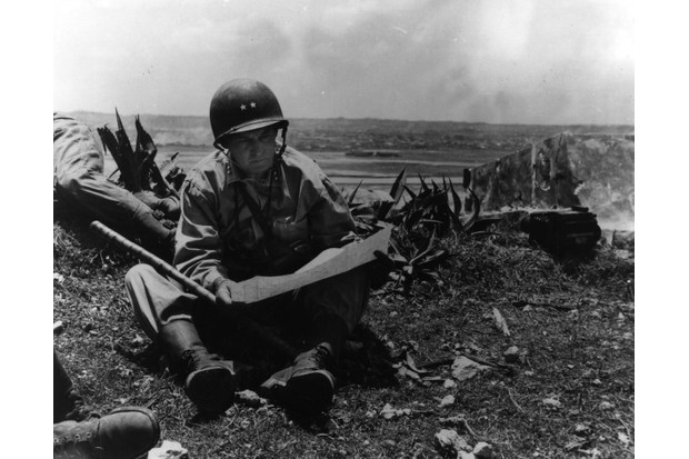 Major General Lemuel Sheperd, commander of the 6th US Marine Division, reading a map on Okinawa. (Photo by MPI/Getty Images)