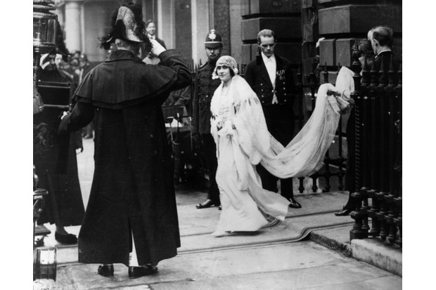 "Lady Elizabeth Bowes-Lyon leaves her home for her wedding to the future King George VI, in 1923. After the First World War, royal weddings became ""valuable crowd-pleasers"" says Sarah Gristwood. (Photo by Central Press/Getty Images)"