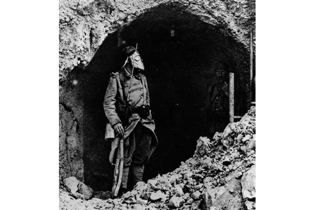 A French soldier at the battle of Verdun wearing a gas mask, 1916.