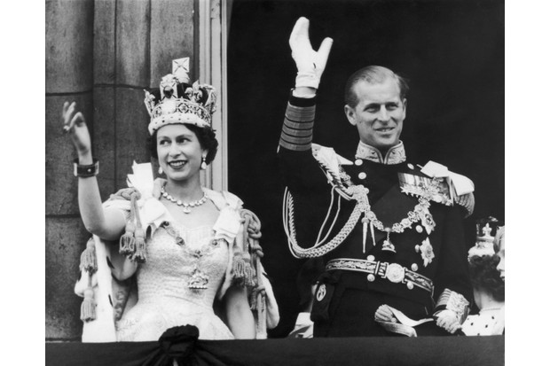 Queen Elizabeth II and Prince Philip, Duke of Edinburgh, wave at the crowds from the balcony at Buckingham Palace on the day of the Queen's coronation, 2 June 1953. (Photo by Keystone/Getty Images)