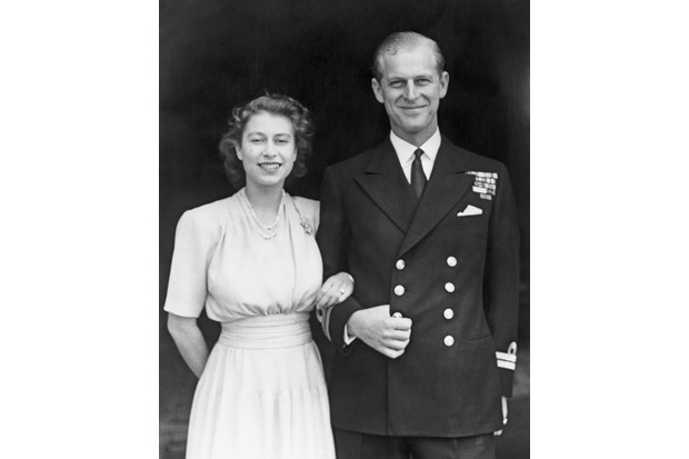 Princess Elizabeth and Prince Philip, Duke of Edinburgh, at Buckingham Palace, London, shortly after they announced their engagement in 1947. (Photo by Fox Photos/Getty Images)