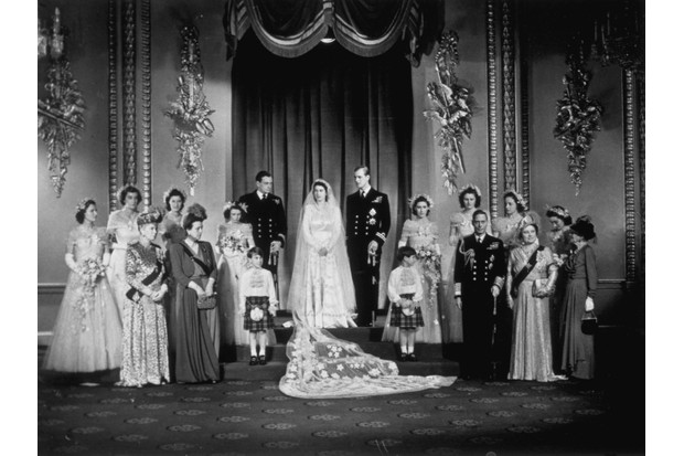 Princess Elizabeth and Prince Philip, Duke of Edinburgh (centre) with King George VI and Queen Elizabeth (right) and members of the immediate and extended Royal Family at Buckingham Palace after their wedding. (Photo by Topical Press Agency/Getty Images)