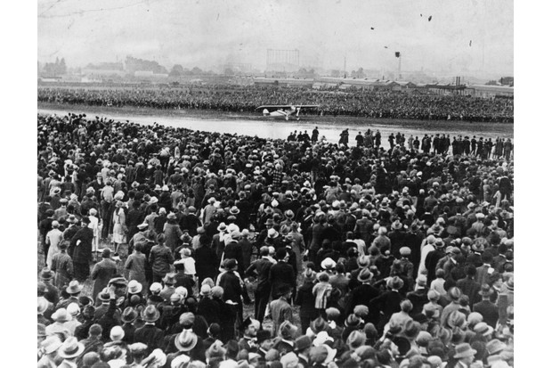 Thousands of spectators watch Charles Lindbergh arriving at Croydon, London in the Spirit of St Louis