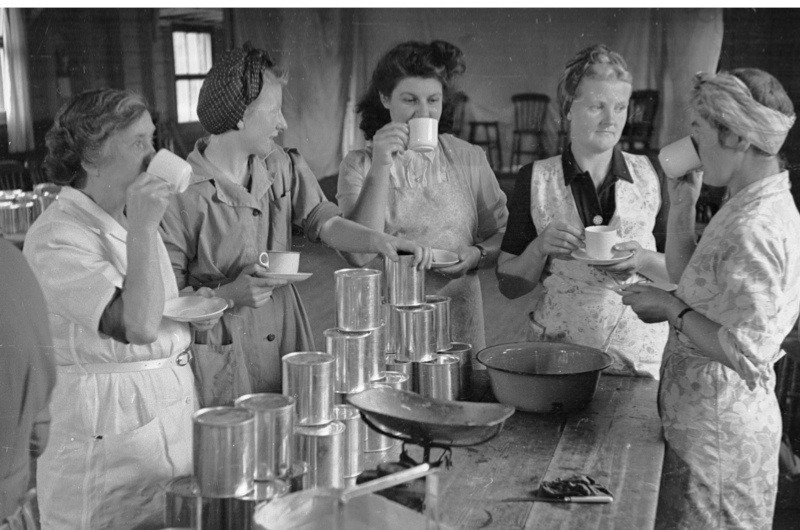 25th September 1948:  Members of a Women's Institute enjoying a tea break during a canning session at Ashton-under-Edge village hall in the Vale of Evesham. Original Publication: Picture Post - 4647 - Canning Club - pub. 1948  (Photo by Kurt Hutton/Picture Post/Getty Images)