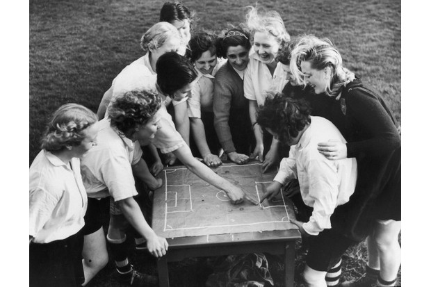 May 1939: Members of the Preston Ladies Football Club listen to their captain as she discusses tactics with the aid of a cloth pitch diagram. Following the FA ban, the football club drew strong crowds, but couldn't emulate what they had achieved before the ban. (Photo by Harry Shepherd/Fox Photos/Hulton Archive/Getty Images)