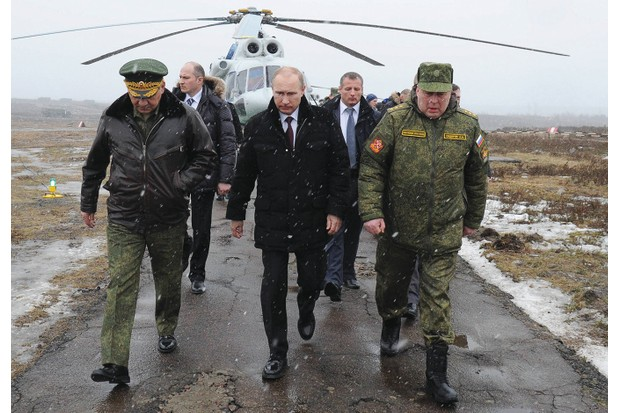 Russian president Vladimir Putin orders military drills in March 2014, shortly after parliament approved the use of Russian troops in Ukraine. (Getty Images)