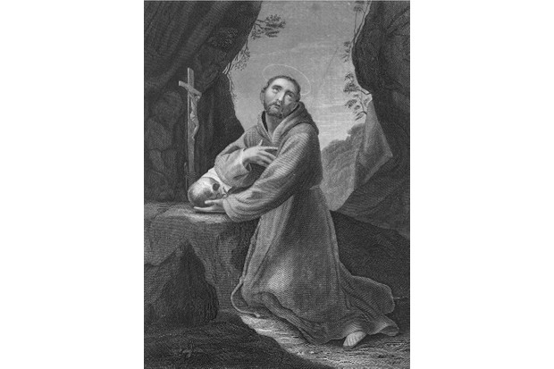 Circa 1220, Portrait of Saint Francis of Assisi (c 1181-1226) kneeling at an rock altar to pray with a skull in his hand. Originally Francescodi Pietro di Bernadone, he was the founder of the monastic order called the Franciscans, which was approved in 1209 by Pope I (Photo by Archive Photos/Getty Images)