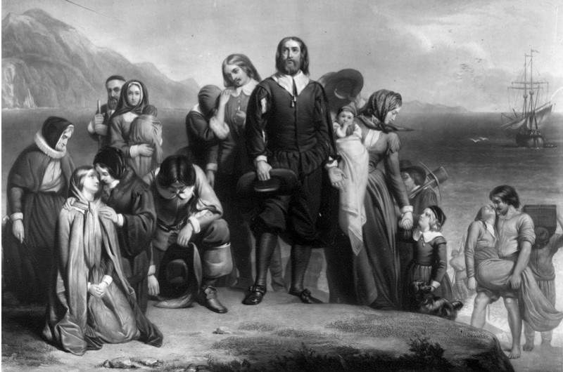 19 November 1620, the Pilgrim Fathers arriving on the Mayflower and landing in New England, where they founded the Plymouth Colony. Original artwork: painting by Charles Lucy. (Photo by Three Lions/Getty Images)