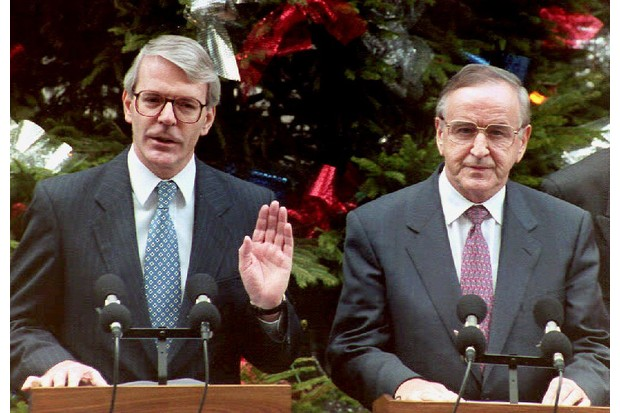 British prime minister John Major (left) and Irish prime minister Albert Reynolds address a press conference in London prior to issuing a joint declaration to bring peace to Northern Ireland, 15 December 1994. (Photo by Gerry Penny/AFP/Getty Images)