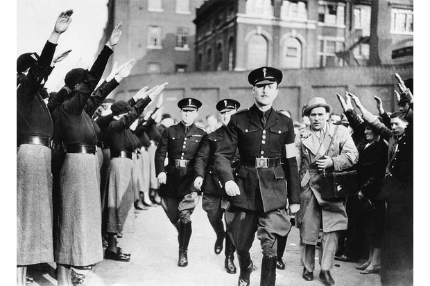 """Sir Oswald Mosley, English Fascist leader, receives a fascist salute from his followers in 1936. The movement proved """"a violent embarrassment"""" says Will Wainewright. (Bettmann/Getty Images)"""