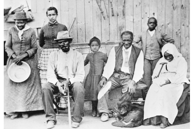 Harriet Tubman (pictured far left) with a group of people she helped to escape from slavery. (Getty Images)