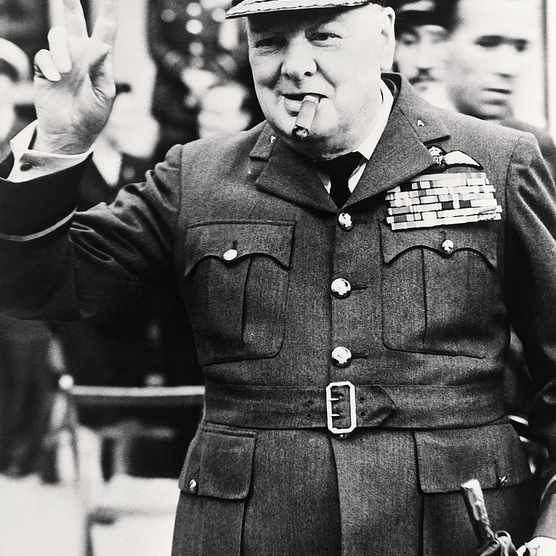 Winston Churchill making the famed 'V' for Victory sign. (Image by Bettmann/Getty Images)
