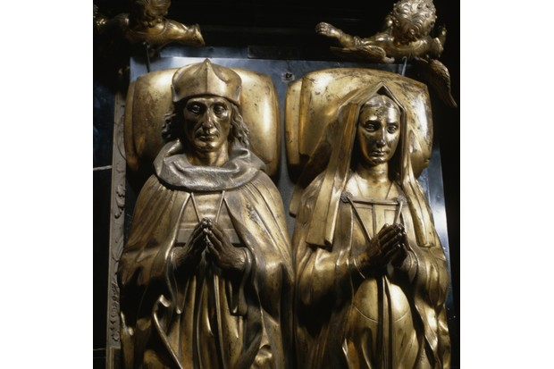 Gilt-bronze tomb effigies of King Henry VII and Elizabeth of York in Henry VII's Chapel in Westminster Abbey. The head and shoulders of the piece by Pietro Torrigiano and made between 1512 and 1519 can be seen. (Photo by Angelo Hornak/Corbis via Getty Images)
