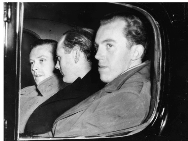 Michael Pitt Rivers, Lord Montagu of Beaulieu and Peter Wildeblood, leaving court after being found guilty of gross indecency for homosexual activity in 1954. (Getty Images)