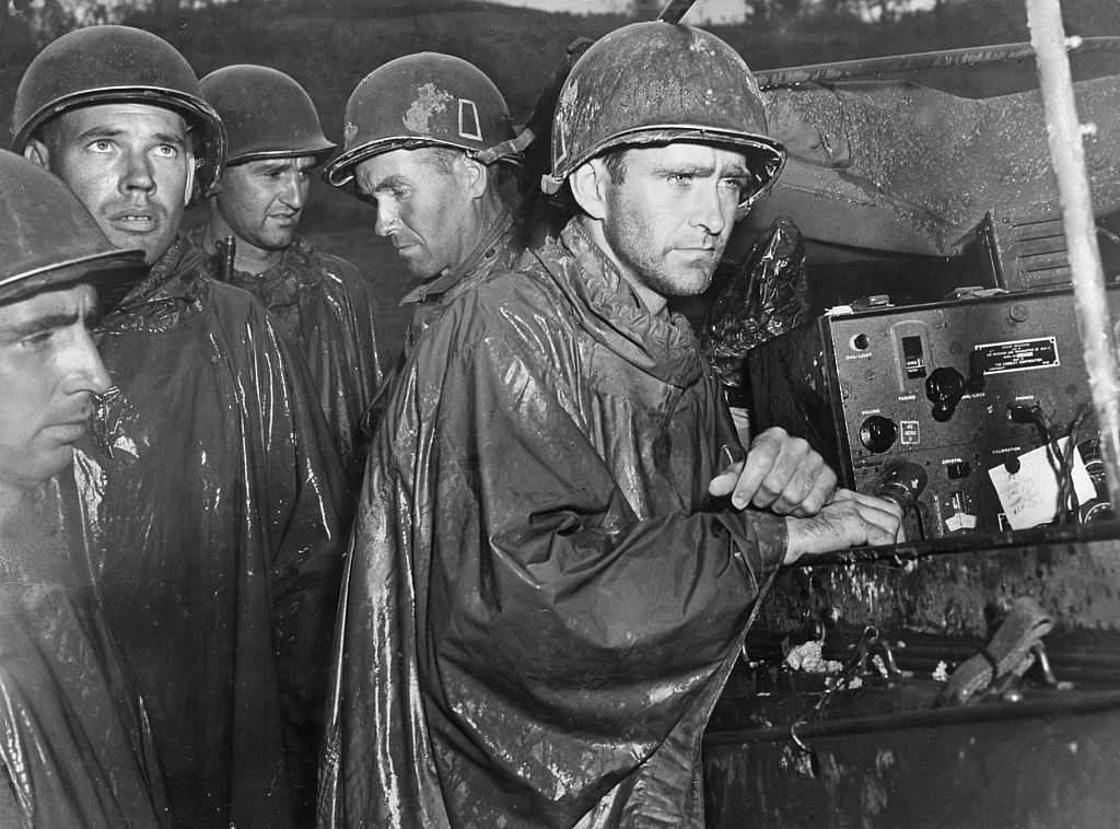 Soldiers of the 77th Infantry Division in Okinawa listen to news of Nazi Germany's surrender. (Photo by ullstein bild/ullstein bild via Getty Images)
