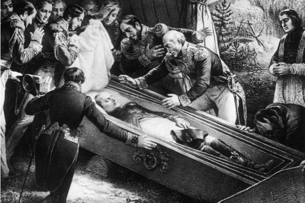 A priest and a group of officers gather round Napoleon's coffin. (General Photographic Agency/Hulton Archive/Getty Images)