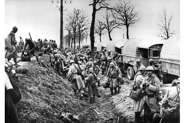 This picture taken in 1916 shows French soldiers unloading trucks near Verdun battlefield, eastern France, during the First World War.