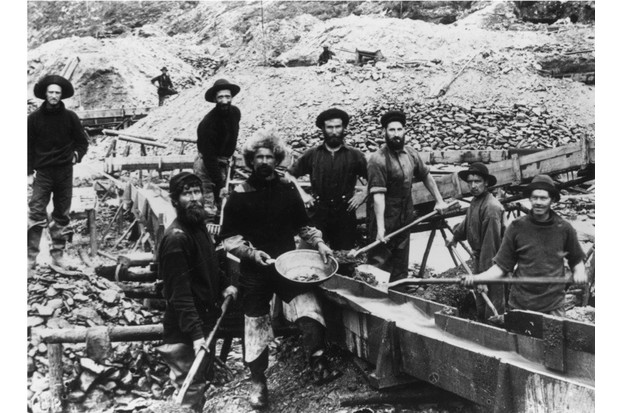 Jubilant miners display a large gold nugget during the Klondike Gold Rush, circa 1897. (Photo by Hulton Archive/Getty Images)