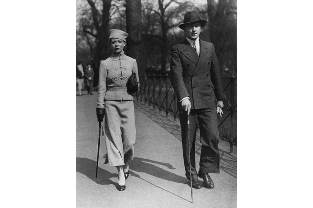A fashionable couple strolling in Hyde Park, London, 22 March 1936. (Photo by Topical Press Agency/Hulton Archive/Getty Images)