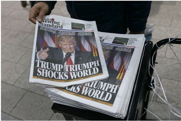 Commuters take copies of the Evening Standard Newspaper in central London on November 9, 2016, showing a picture of newly elected US President Donald Trump and reporting on the result of the US presidential election. Political novice and former reality TV star Donald Trump has defeated Hillary Clinton to take the US presidency, stunning America and the world in an explosive upset fueled by a wave of grassroots anger. / AFP / DANIEL LEAL-OLIVAS (Photo credit should read DANIEL LEAL-OLIVAS/AFP/Getty Images)