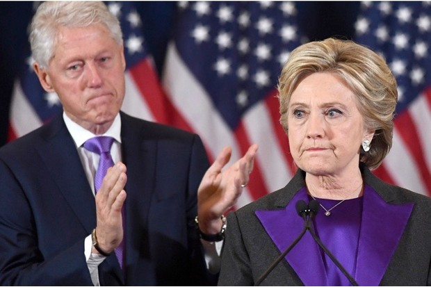 US Democratic presidential candidate Hillary Clinton makes a concession speech after being defeated by Republican President-elect Donald Trump, as former President Bill Clinton looks on in New York on November 9, 2016. / AFP / JEWEL SAMAD (Photo credit should read JEWEL SAMAD/AFP/Getty Images)