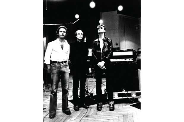 """BERLIN - 1977: Robert Fripp, Brian Eno and David Bowie pose for a portrait in the studio where they are recorded """"Heroes"""" in 1977 in Berlin, Germany. Photo by Michael Ochs Archives/Getty Images"""
