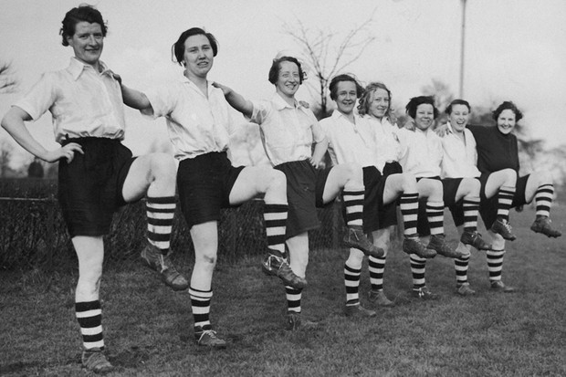Members of Preston Ladies' Football Club (formerly Dick, Kerrâs Ladies) pose while carrying out leg exercises during practice, March 1937. (Photo by Fox Photos/Hulton Archive/Getty Images)