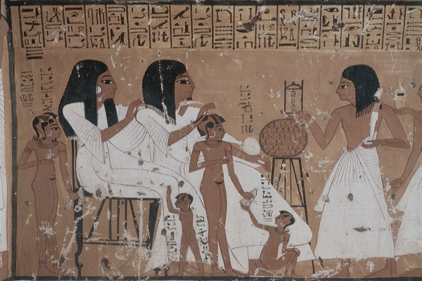 Mural of women with children, from the tomb of Khai–Inherkha, Thebes. (Photo by DEA / G Dagli Orti/De Agostini/Getty Images)