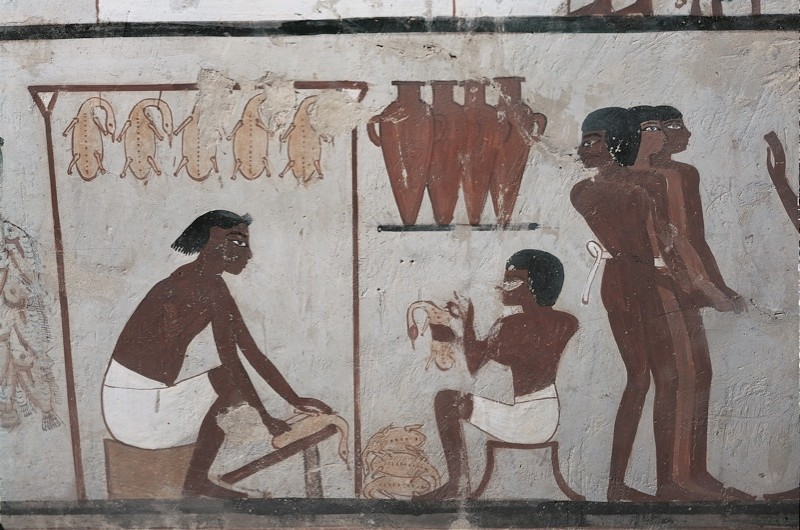 Theban mural showing people plucking geese. (Photo by DEA / G Dagli Orti/De Agostini/Getty Images)
