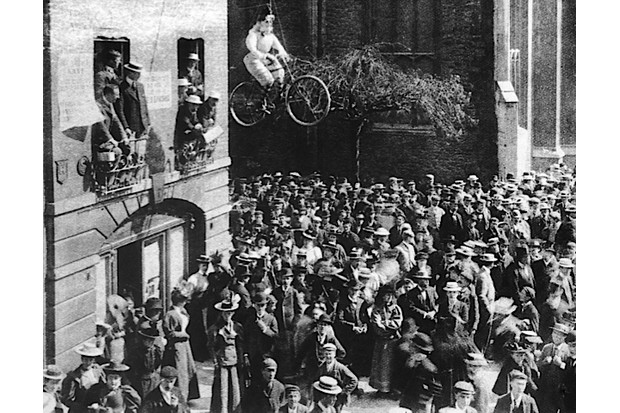 Male undergraduates at Cambridge University protest against the full admission of female students by hanging an effigy of a 'New Woman' on a bicycle from a window in 1897. (Photo by Hulton Archive/Getty Images)