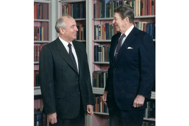 Soviet secretary general Mikhail Gorbachev and US president Ronald Reagan at a summit meeting in Washington, DC, 1987. (Photo by White House/Getty Images)