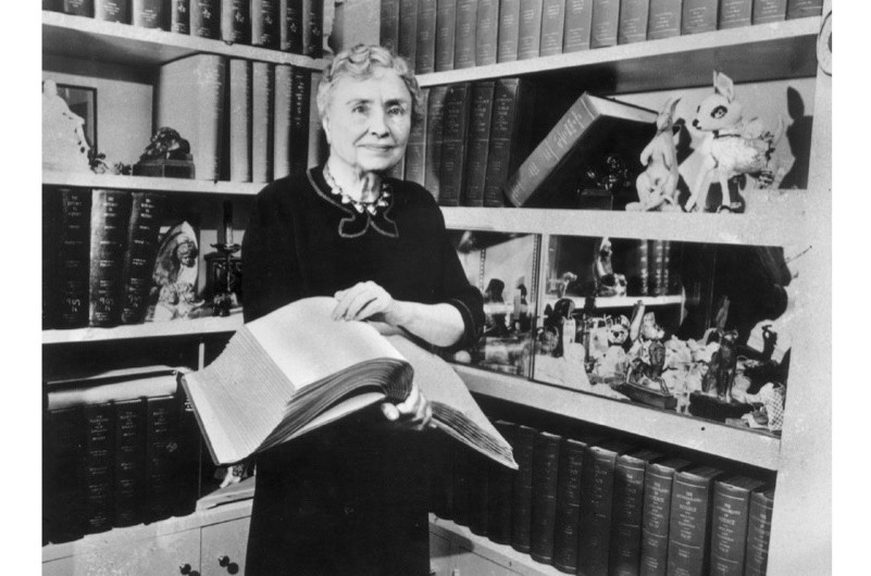 A portrait of Helen Keller (1880-1968) holding a Braille volume, c1956. Keller, who was both blind and deaf, was an American writer, educator and advocate for the disabled. (Hulton Archive/Getty Images)
