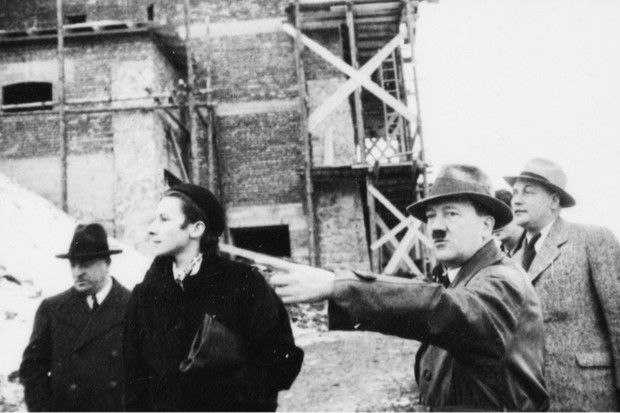 Photograph by Heinrich Hoffmann of Hitler and architects visiting the construction site of the Berghof around Christmas 1935. From left to right: Leonhard Gall, Gerdy Troost, Hitler, and Wilhelm Brückner, Hitler's chief adjutant. (United States National Archives, College Park, Maryland)
