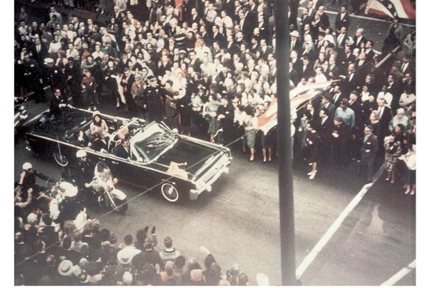 President John F Kennedy, First Lady Jacqueline Kennedy and Texas governor John Connally ride through the streets of Dallas