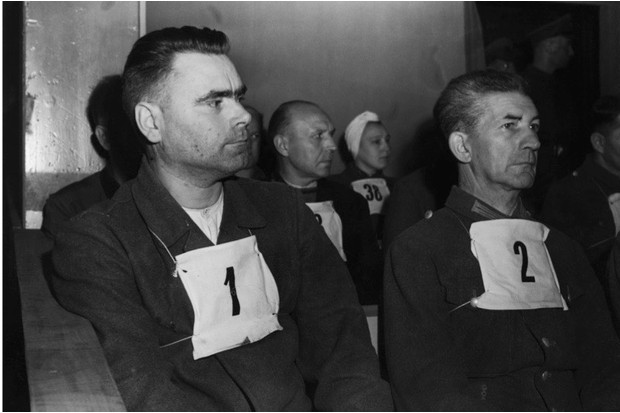 Joseph Kramer, the SS commandant of Bergen-Belsen at its liberation, (left), and Fritz Klein, the camp doctor, sit in the dock before a court in Lüneburg in September 1945. (Photo by Bettmann/Getty Images)
