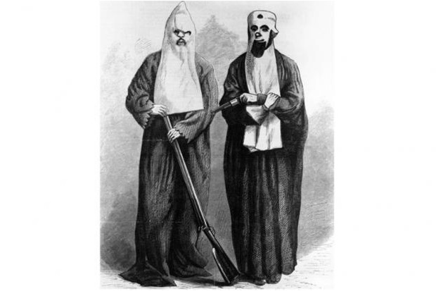 1866: A wood engraving depicting two members of the Ku Klux Klan. The white sheet and hood were supposed to represent the ghosts of Confederate soldiers risen from the dead to seek revenge. Formed in Pulaski, Tennessee, the Ku Klux Klan held its first meeting on 25 December 1865. (MPI/Getty Images)