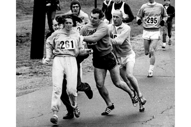 An official tries to block Kathy Switzer at the 1967 Boston Marathon. (Photo by Paul J Connell/The Boston Globe via Getty Images)