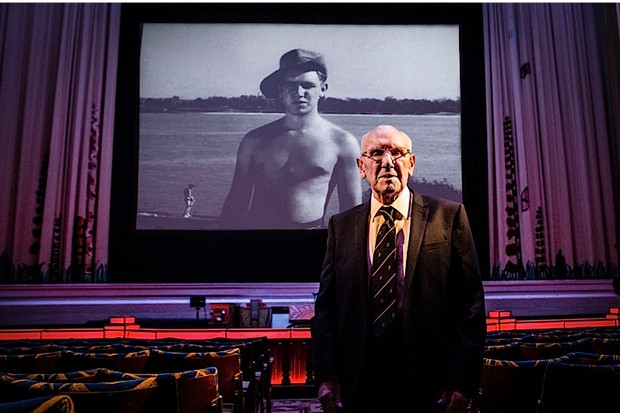 Kenneth-Chadwick-92-year-old-Burman-veteran-with-his-Calling-Blighty-message-on-the-screen-behind-him-219-ee6c67a
